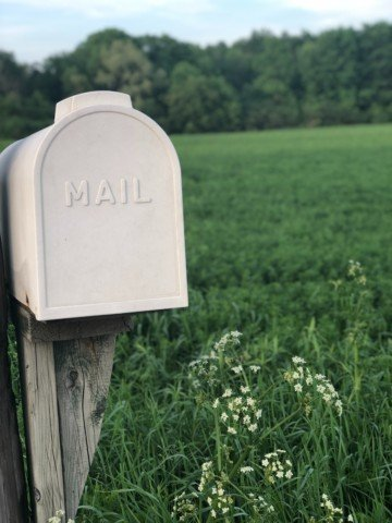 shallow focus photography of gray mailbox