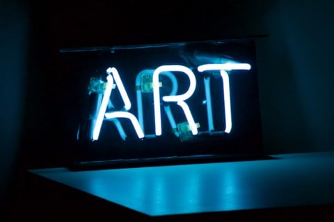blue Art neon sign turned on