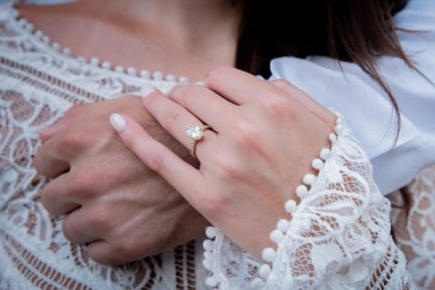 woman wearing gold diamond ring