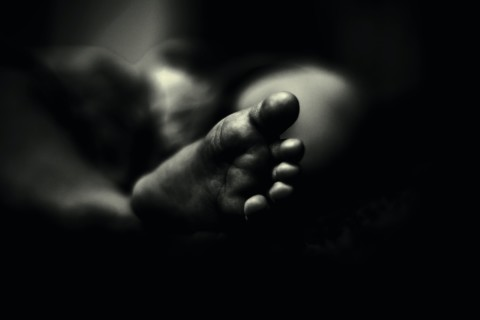 greyscale photo of person's feet
