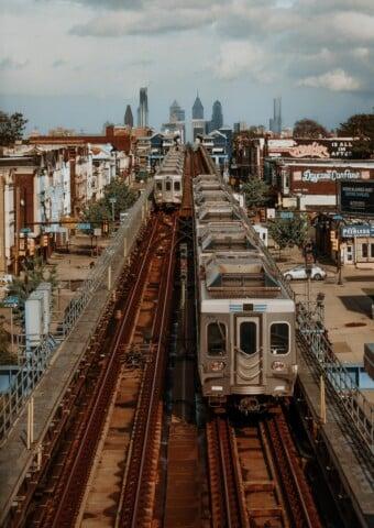 white train on rail road during daytime