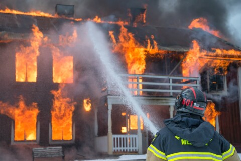 fireman watering fire