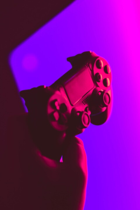 person holding black and gray game controller